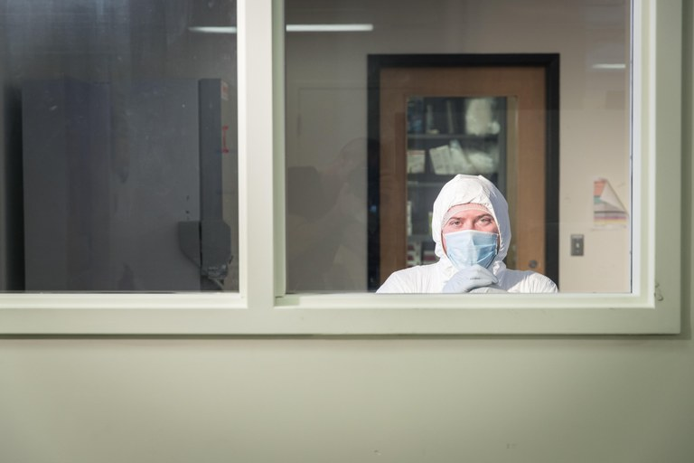 Graduate student Emil Karpinski in the Sample Prep Room of the McMaster Ancient DNA Centre Clean Labs. Credit: JD Howell, McMaster University