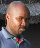 John B A Okello
